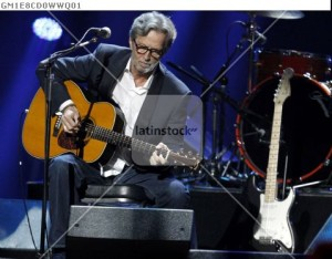 "Eric Clapton performs during ""12-12-12"" benefit concert for victims of Superstorm Sandy in New York"