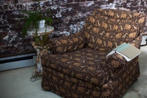 Still life of armchair and book in conservatory