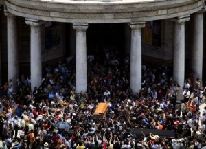 People carry the coffin of Mexican writer Monsivais outside Bellas Artes museum in Mexico City