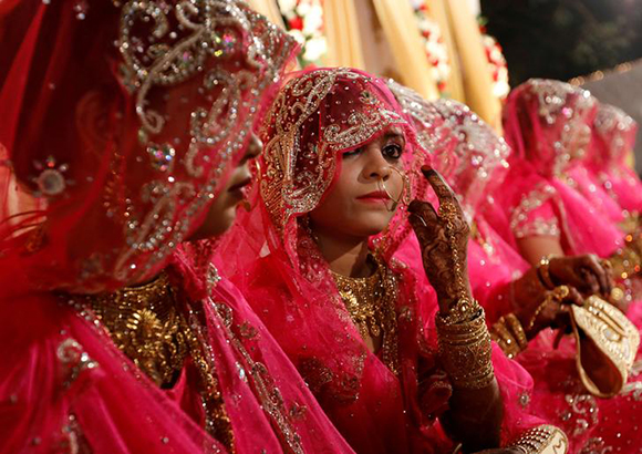 Muslim brides wait for the start of a mass marriage ceremony in Mumbai, India. Photo by Danish Siddiqui