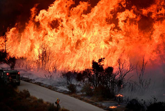 Fire fighters attack the Thomas Fire's north flank with backfires as they continue to fight a massive wildfire north of Los Angeles, near Ojai , California, U.S., December 9, 2017. Photo by Gene Blevins