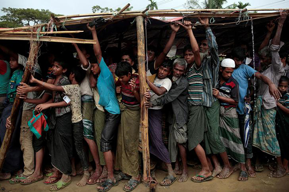 Rohingya refugees jostle as they line up for a blanket distribution under heavy rainfall at the Balukhali camp near Cox's Bazar, Bangladesh. Photo by Alkis Konstantinidis