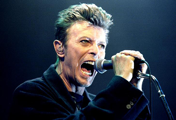Remembering David Bowie British Pop Star David Bowie screams into the microphone as he performs on stage during his concert in Vienna February 4, 1996. Photo by Leonhard Foeger