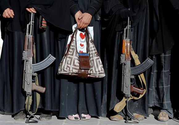 Armed women attend a rally to show support to the Houthi movement in Sanaa, Yemen January 13, 2018. Photo by Khaled Abdullah