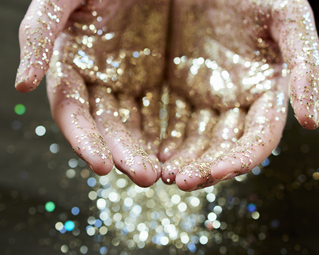 Hands cupping gold glitter. Credit: F020/6550 CAIA Image / Science Photo Library